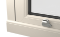 INTERNAL CORNER OF uPVC VERTICAL SLIDING SASH WINDOW (COLOUR - CREAM WOODGRAIN)